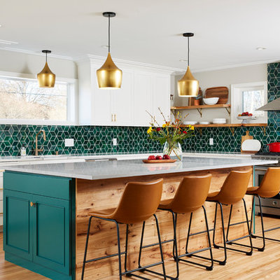Large transitional l-shaped light wood floor and beige floor kitchen photo in Minneapolis with white cabinets, ceramic backsplash, an island, recessed-panel cabinets, green backsplash, stainless steel appliances and gray countertops