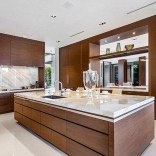 Large contemporary kitchen remodeling - Kitchen - large contemporary u-shaped marble floor and white floor kitchen idea in Miami with flat-panel cabinets, medium tone wood cabinets, onyx countertops, an island, beige countertops, an undermount sink, white backsplash and stone slab backsplash