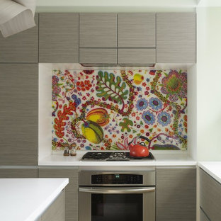 Inspiration for an eclectic kitchen remodel in New York with stainless steel appliances, flat-panel cabinets, gray cabinets and multicolored backsplash