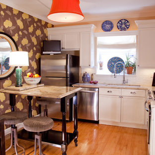 Eclectic kitchen appliance - Eclectic l-shaped kitchen photo in Chicago with an undermount sink, recessed-panel cabinets, white cabinets, white backsplash and stainless steel appliances