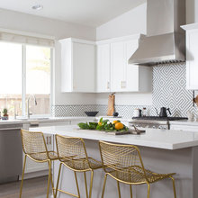 Black and Brass Amp Up a White Kitchen