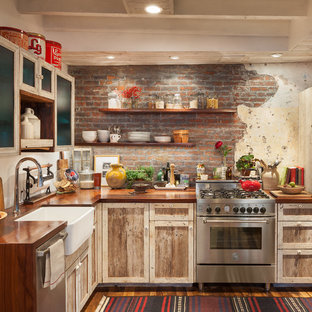 Small rustic eat-in kitchen appliance - Inspiration for a small rustic l-shaped medium tone wood floor and brown floor eat-in kitchen remodel in Philadelphia with a farmhouse sink, shaker cabinets, light wood cabinets, wood countertops, red backsplash, brick backsplash, stainless steel appliances, no island and brown countertops