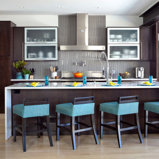 Inspiration for a contemporary galley kitchen in Denver with flat-panel cabinets, dark wood cabinets, grey splashback, light hardwood floors and with island.