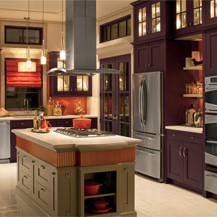 Photo of a large traditional l-shaped kitchen/diner in New York with a built-in sink, shaker cabinets, purple cabinets, composite countertops, orange splashback, mosaic tiled splashback, stainless steel appliances, ceramic flooring, an island and beige floors.