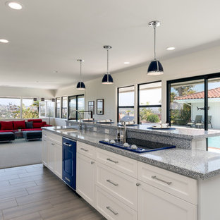 Design ideas for a large transitional single-wall eat-in kitchen in San Diego with an undermount sink, raised-panel cabinets, white cabinets, granite benchtops, multi-coloured splashback, ceramic splashback, coloured appliances, porcelain floors, with island, beige floor and blue benchtop.