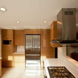 Photo of a mid-sized asian u-shaped separate kitchen in Vancouver with an undermount sink, flat-panel cabinets, light wood cabinets, quartzite benchtops, white splashback, stainless steel appliances and marble floors.