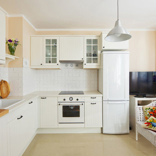 Inspiration for a mid-sized traditional l-shaped separate kitchen in Sydney with a farmhouse sink, shaker cabinets, beige cabinets, quartz benchtops, white splashback, ceramic splashback, white appliances, porcelain floors, no island and beige floor.