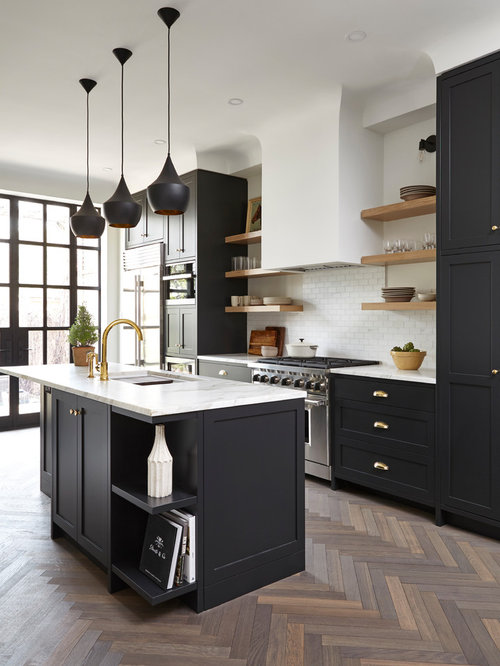 Transitional kitchen designs  Example of a transitional medium tone wood floor design in Toronto Black Kitchen Cabinets Houzz