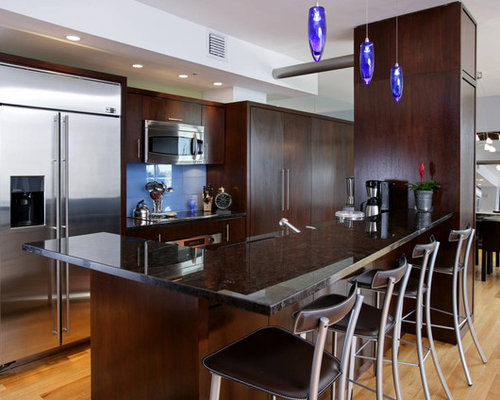 Contemporary Galley Kitchen Idea In Boston With Flat Panel Cabinets Dark Wood Cabinets