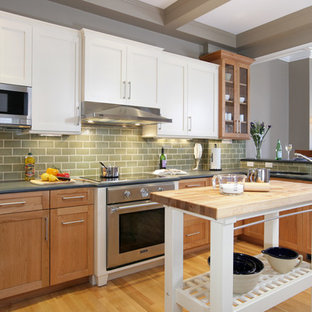 Eat-in kitchen - traditional u-shaped eat-in kitchen idea in Boston with an undermount sink, shaker cabinets, light wood cabinets, granite countertops, green backsplash, ceramic backsplash and stainless steel appliances