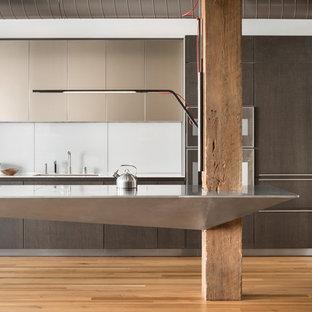 Industrial Kitchen Designs   Inspiration For An Industrial Light Wood Floor  And Beige Floor Kitchen Remodel