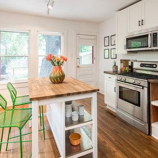 Mid-century modern kitchen pictures - 1960s kitchen photo in Austin