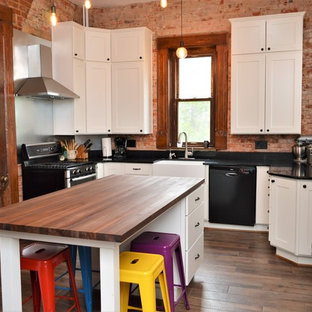 Bourbon, IN. Haas Signature Collection. Farmhouse Kitchen with Exposed Brick