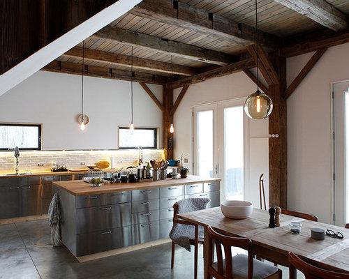 Cucina in montagna con ante in acciaio inossidabile foto - Paraspruzzi per cucina ...