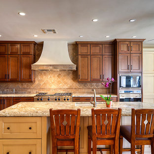 Inspiration for a traditional l-shaped kitchen in Phoenix with shaker cabinets, medium wood cabinets, granite benchtops, beige splashback, stainless steel appliances, an undermount sink, ceramic splashback, ceramic floors, with island, grey floor and grey benchtop.
