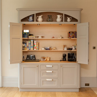 Traditional kitchen in Hampshire with recessed-panel cabinets and beige cabinets.