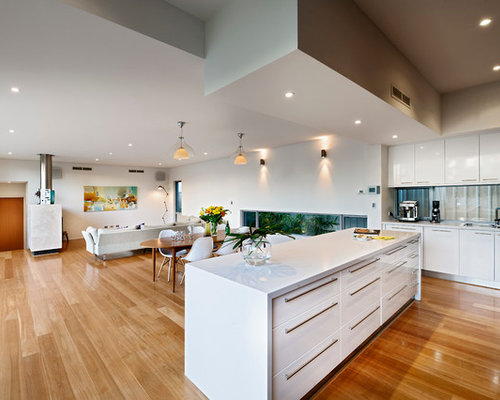 modern open concept kitchen idea in perth with flat panel cabinets and