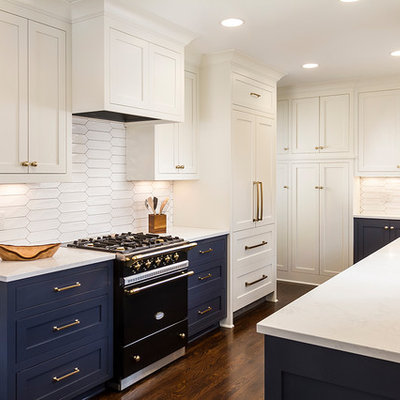 Example of a mid-sized transitional galley dark wood floor and brown floor eat-in kitchen design in Minneapolis with an undermount sink, shaker cabinets, white cabinets, quartz countertops, white backsplash, ceramic backsplash, paneled appliances and no island