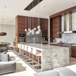 Inspiration for a large contemporary u-shaped kitchen/diner in Seattle with a submerged sink, flat-panel cabinets, dark wood cabinets, marble worktops, grey splashback, stone slab splashback, stainless steel appliances, porcelain flooring, an island, white floors and grey worktops.