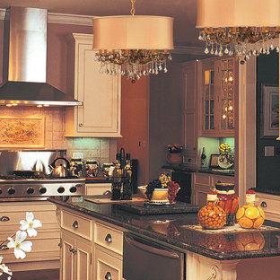 Mid-sized elegant single-wall medium tone wood floor kitchen photo in New York with a drop-in sink, beaded inset cabinets, light wood cabinets, marble countertops, beige backsplash, ceramic backsplash, stainless steel appliances and an island