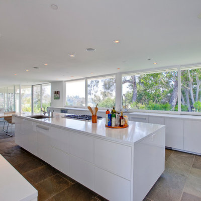 Inspiration for a modern eat-in kitchen remodel in Los Angeles with an undermount sink, flat-panel cabinets and white cabinets