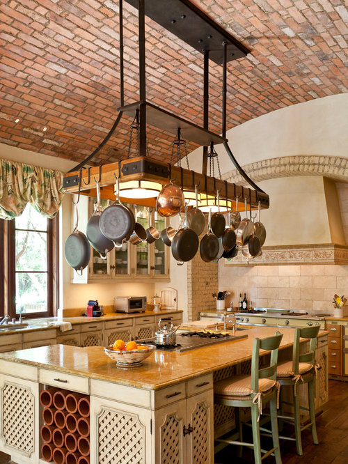 Tuscan kitchen photo in Orange County with an undermount sink,  recessed-panel cabinets, - Hanging Pot Rack Houzz
