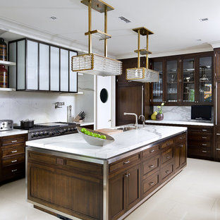 Trendy l-shaped kitchen photo in Toronto with an undermount sink, recessed-panel cabinets, dark wood cabinets, white backsplash, stainless steel appliances and marble backsplash