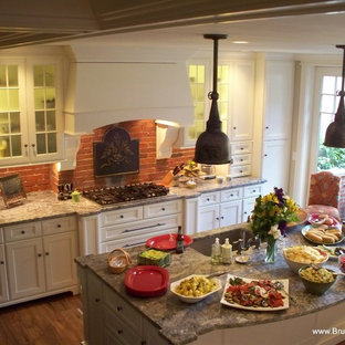Small traditional kitchen pantry designs - Small elegant galley medium tone wood floor kitchen pantry photo in Boston with recessed-panel cabinets, white cabinets, granite countertops, an island and red backsplash