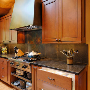 Inspiration for a timeless kitchen remodel in Seattle with recessed-panel cabinets, medium tone wood cabinets and gray backsplash