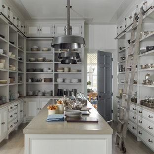 Large country kitchen pantry in New York with open cabinets, white cabinets, light hardwood floors, with island and beige floor.