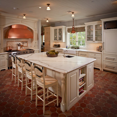 Inspiration for a timeless kitchen remodel in Houston with a farmhouse sink, glass-front cabinets, beige cabinets, white backsplash, subway tile backsplash and paneled appliances