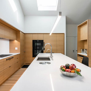 Modern Kitchen Inspiration   Example Of A Minimalist L Shaped Medium Tone  Wood Floor And