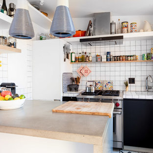 Photo of a small modern u-shaped kitchen in New York with an integrated sink, open cabinets, white splashback, porcelain splashback, stainless steel appliances and a peninsula.