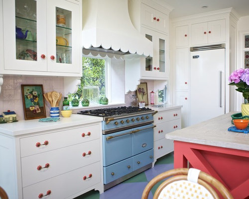 eclectic open concept kitchen idea in los angeles with glassfront cabinets white cabinets