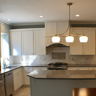 Large traditional eat-in kitchen appliance - Inspiration for a large timeless u-shaped terrazzo floor and gray floor eat-in kitchen remodel in Cleveland with an undermount sink, shaker cabinets, white cabinets, granite countertops, white backsplash, ceramic backsplash, stainless steel appliances and an island