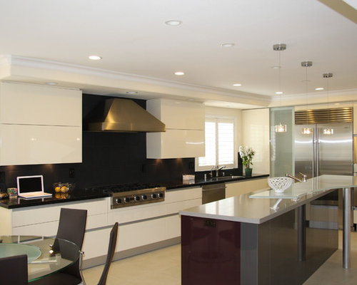Contemporary kitchen idea in Other with stainless steel appliances