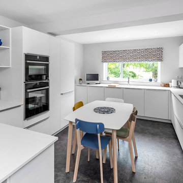 Bright white family kitchen with a touch of blue