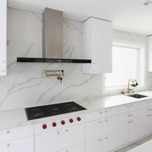 Design ideas for a large contemporary eat-in kitchen in New York with an undermount sink, flat-panel cabinets, white cabinets, quartzite benchtops, multi-coloured splashback, stone slab splashback, stainless steel appliances, ceramic floors, with island, yellow floor and white benchtop.