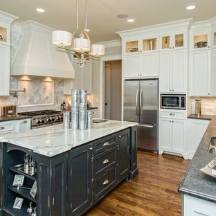 Large elegant u-shaped dark wood floor eat-in kitchen photo in Other with a double-bowl sink, recessed-panel cabinets, white cabinets, gray backsplash, subway tile backsplash, stainless steel appliances, marble countertops and an island