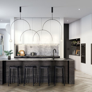 Large contemporary kitchen pantry in Melbourne with an undermount sink, flat-panel cabinets, white cabinets, marble benchtops, grey splashback, marble splashback, black appliances, light hardwood floors, with island, grey floor and grey benchtop.