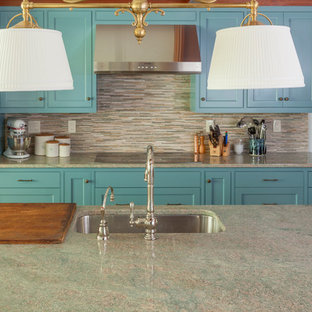 Large traditional eat-in kitchen appliance - Large elegant single-wall eat-in kitchen photo in Portland Maine with a single-bowl sink, shaker cabinets, blue cabinets, granite countertops, brown backsplash, glass tile backsplash, stainless steel appliances, an island and turquoise countertops