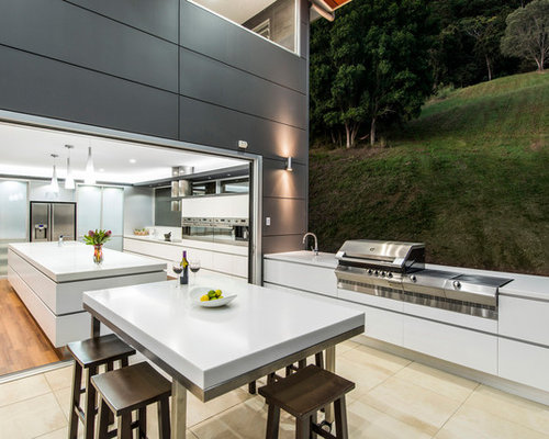 Inspiration For A Contemporary Kitchen Remodel In Brisbane With Flat Panel  Cabinets