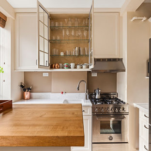 traditional kitchen appliance inspiration for a timeless u shaped kitchen remodel in new york - Beige Kitchen Cabinets