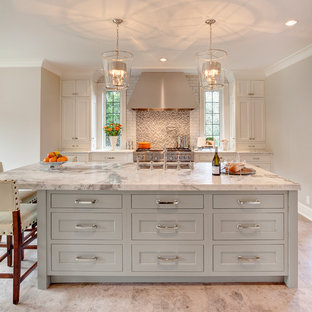 Transitional kitchen remodeling - Inspiration for a transitional kitchen remodel in Seattle with an island and white countertops