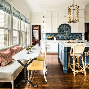 Traditional eat-in kitchen designs - Inspiration for a timeless dark wood floor eat-in kitchen remodel in San Francisco with an undermount sink, shaker cabinets, white cabinets, blue backsplash, stone tile backsplash and an island