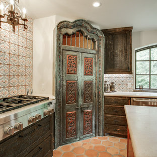 Design ideas for a large mediterranean u-shaped eat-in kitchen in Dallas with an undermount sink, shaker cabinets, distressed cabinets, quartz benchtops, multi-coloured splashback, porcelain splashback, stainless steel appliances, terra-cotta floors and with island.