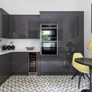 This is an example of a small contemporary l-shaped kitchen/diner in London with flat-panel cabinets, grey cabinets, ceramic flooring, no island and white floors.