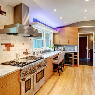Large midcentury u-shaped eat-in kitchen in Milwaukee with an undermount sink, flat-panel cabinets, light wood cabinets, granite benchtops, white splashback, stone tile splashback, stainless steel appliances, light hardwood floors and no island.