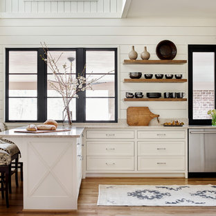 Mid-sized country u-shaped eat-in kitchen in Atlanta with white cabinets, stainless steel appliances, medium hardwood floors, a peninsula, brown floor, an undermount sink, recessed-panel cabinets, marble benchtops, white splashback and white benchtop.