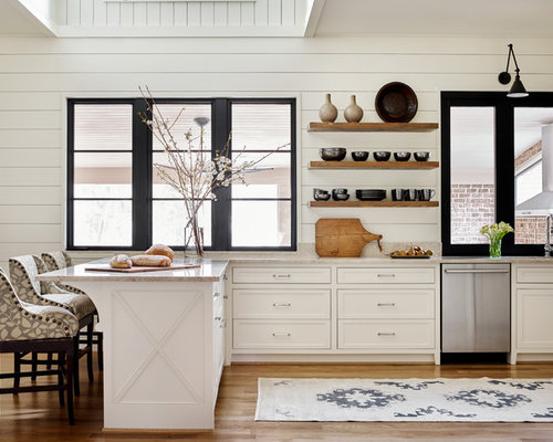 Farmhouse kitchen appliance  Example of a country medium tone wood floor and brown 25 Best Kitchen Ideas Houzz
